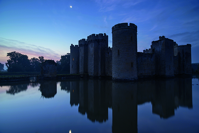Bodiam Castle, East Sussex, reflected in the moat just before dawn. Castles in England