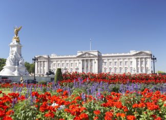 Buckingham Palace With Flowers Blooming In The Queen's Garden, London, England. Credit: Shutterstock