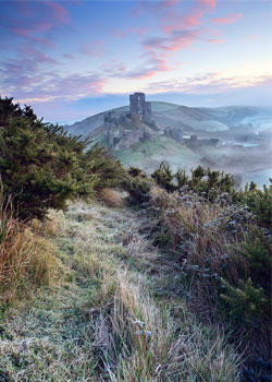 Last years talented winner, Dorset photographer Antony Spencer, captures a scene of frosty dawn colours in a 'Winter mist at Corfe Castle, Dorset, England'.