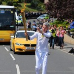 Jonathan Edwards carries the Olympic Flame