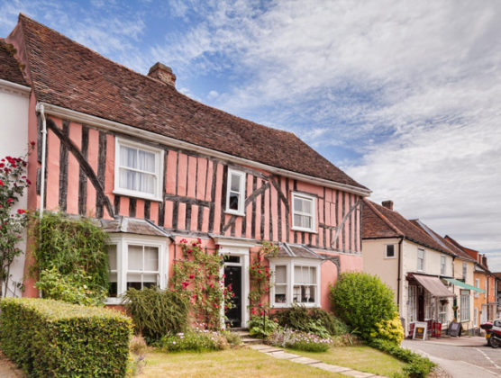 A beautiful example of a timber-framed house in Lavenham, painted in Suffolk pink. Credit: Travellinglight/Alamy