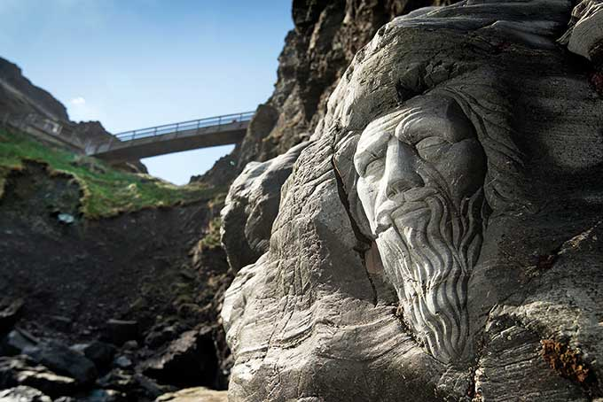 Tintagel Castle - Merlin's face carved into the rock, on the beach. Credit: Emily Whitfield-Wicks Photography