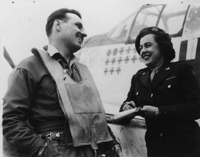 Virginia Irwin was a features writer froma Missouri newspaper. In the photograph, she is showninterviewing Lieutenant Glennon T 'Bubbles' Moran of the 352nd Fighter Group at Bodney air base in Norfolk.