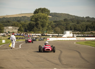 Vintage racing car on the racetrack at Goodwood Revival festival, Goodwood, England. Credit: Visit Britain