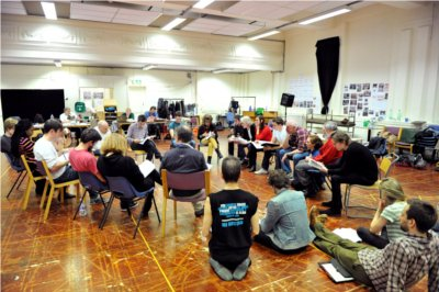 Heads down: the cast of Hamlet reads through Shakespeare's Hamlet. Photo compliments of Keith Pattison.
