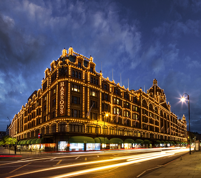 Harrods department store in Knightsbridge is lit up at night with a huge array of lights, silhouetting the building features. Credit: VistBritain/Andrew Pickett