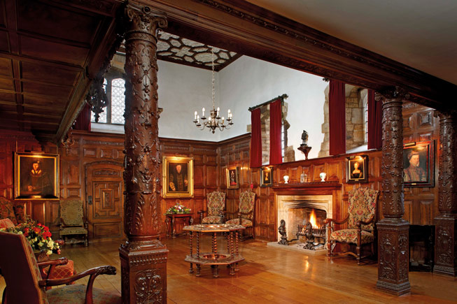 The intricate wood-carved gallery in the Inner Hall at Hever Castle. Credit: images courtesy of Hever Castle
