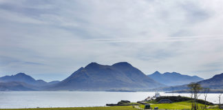 Isle of Raasay Distillery with views towards Skye. best Scottish whisky tours