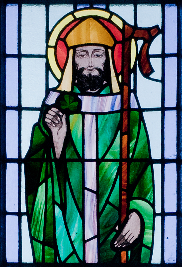 St Patrick as depicted on St. Benin's Church Window, Kilbennan. History of St Patrick's Day