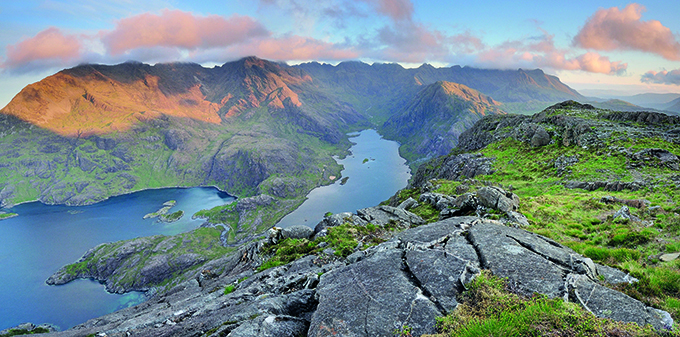 Panoramic view from the summit of Sgurr na Stri on the Isle of Skye, looking over Loch Coruisk towards the Black Cuillin ridge. Credit: Stewart Smith Alamy