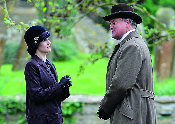 Michelle Dockery and Hugh Bonneville in character as lady Mary Crawley and Lord Grantham for Downton Abbey filming in Bampton. Credit: Wakeham/Splash News/Corbis