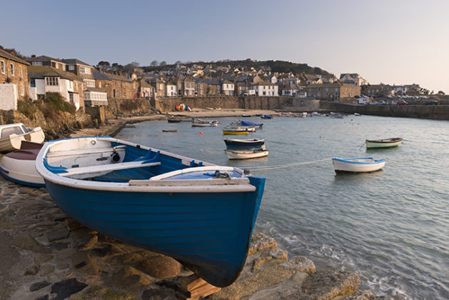 Fishing boat on the harbour wall in the Cornish fishing village of Mousehole, cornwall. Beautiful photos of Cornwall