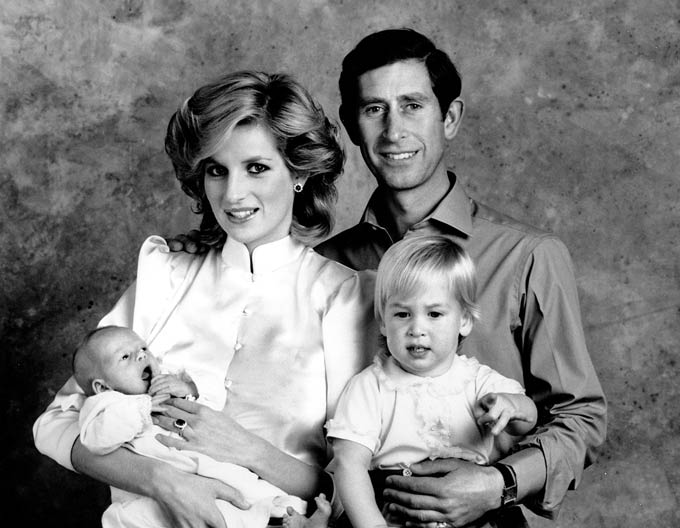 Prince Charles and Princess Diana pose for a family portrait with their sons Prince William and prince Harry at Kensington Palace