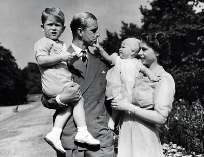 The then Princess Elizabeth stands with her husband Prince Philip and their children Prince Charles and Princess Anne in 1951 © Press Association