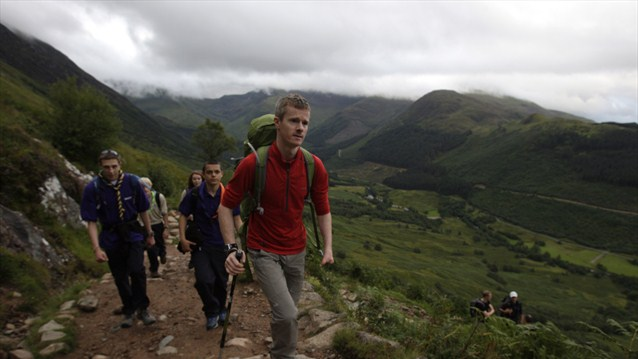 Scouts from communities local to Ben Nevis climb the mountain ready to create the Scottish National Flame as part of the London 2012 Paralympic Torch Relay