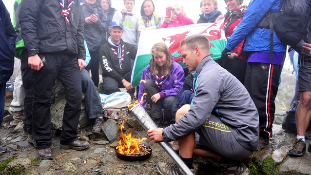 Scouts chosen from communities local to Snowdon used a ferrocerium rod, struck against a rough steel surface, to create the sparks that created the Welsh National Flame, close to the peak of Snowdon.