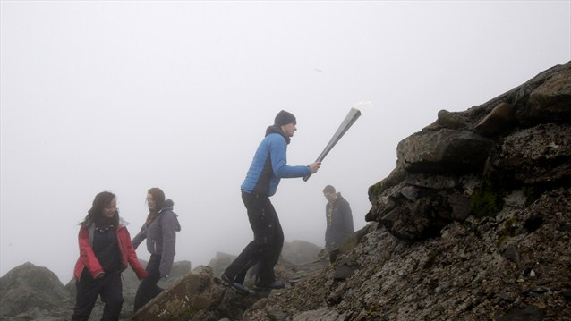 Mountaineer Kevin Shields, from Fort William, embarks on the final climb of Ben Nevis, carries the Scottish National Flame to the peak of the mountain