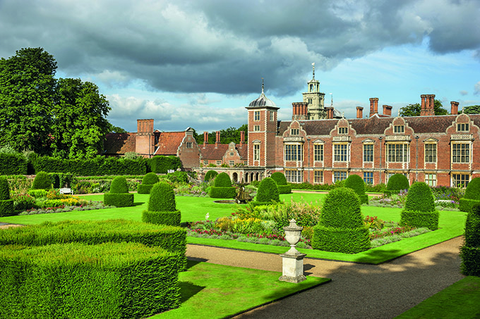 The Parterre Garden at Blickling Estate, Norfolk. Blickling is a turreted red-brick Jacobean mansion, sitting within beautiful gardens and parkland.