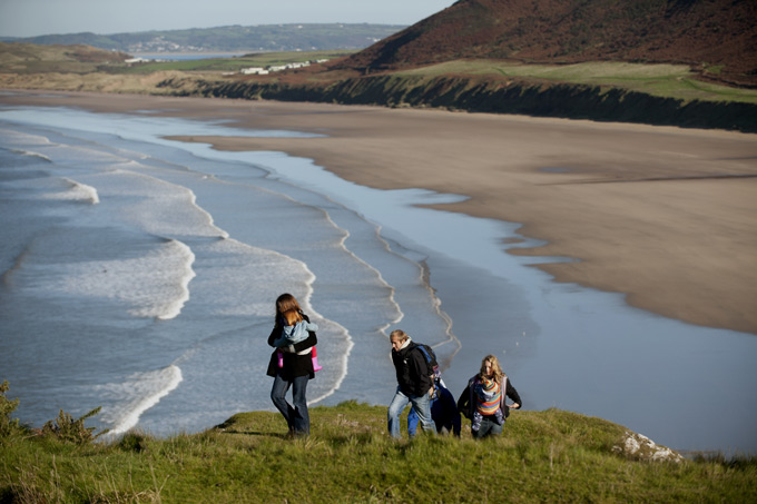 People-walking-above-Rhossili-Bay,-Gower,-Wales-©NTPL-John-Millar
