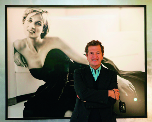 Mario Testino stands in front of one of his famous portraits of Princess Diana taken during her last photoshoot. Credit: by MJ Kim/Getty Images | Princess Diana: fashion icon | Diana, her fashion story