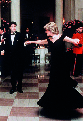 Princess Diana dances with John Travolta at the White House in 1985. Credit: Anwar Hussein/Getty Images | Princess Diana: Fashion icon | Diana, her fashion story