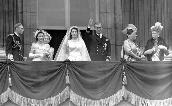 The Royal Wedding of 1947 Britain's Queen Elizabeth II, then Princess Elizabeth, and her husband Prince Philip, the Duke of Edinburgh, wave to the crowd from the balcony of Buckingham Palace, London, in this Nov. 20, 1947 file photo, after their wedding. Image Credit: PA Pictures