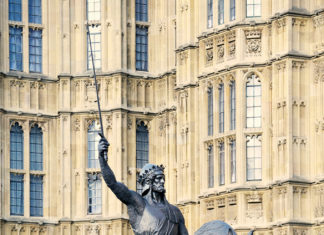 A statue of King Richard I stands outside the Houses of Parliament, London