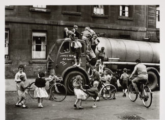 Children playing on a lorry, Glasgow, 1958, by Roger Mayne. When We Were Young exhibition at the National Galleries of Scotland