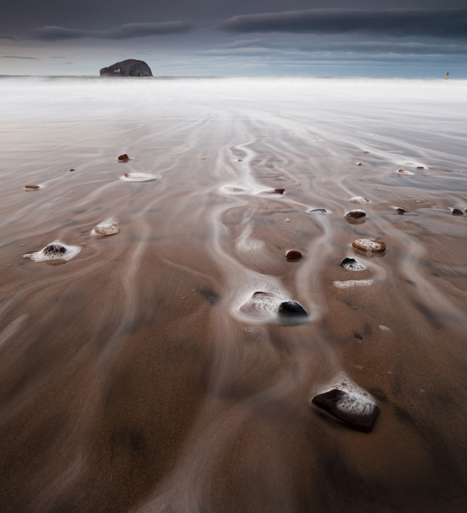 Sea foam at Bass Rock, Firth of Forth, Scotland