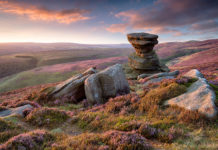 The heather-clad Slat Cellar in the Derwent Valley in the Peak District. Peak District Photos