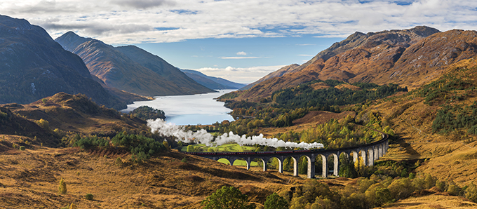 Jacobite train goes over the Glenfinnan Viaduct, Scotland