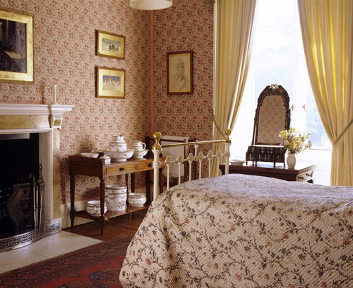 The 'O' Room at Blickling Hall, showing the Victorian bedstead in iron & brass with an unusual mid to late 18th-century quilted chintz counterpane by Copeland. Anne Boleyn's birthplace