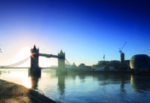 The sun rises behind Tower Bridge, on the Thames, London. Ancient history of London, Britain