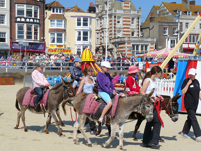 Donkey rides on Weymouth Beach, credit Steve Davies
