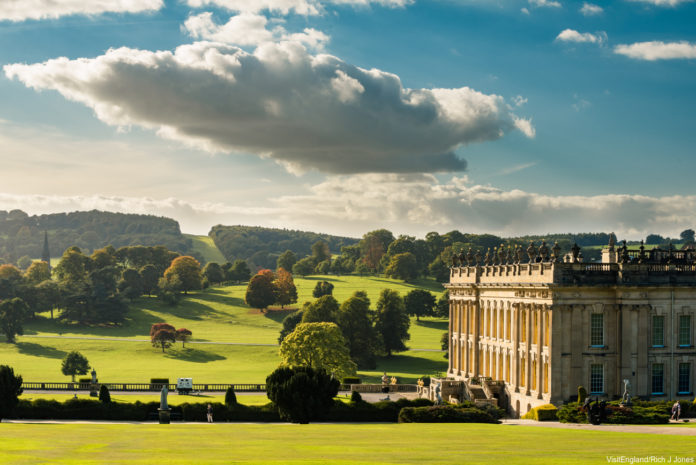 View over the historic Chatsworth House, Derbyshire, England. The house sits in parkland laid out by Capability Brown. Credit: VisitEngland/Rich J Jones