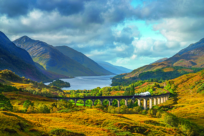 The Jacobite steam train crosses the Glenfinnan Viaduct on the West Highland Rail. Credit: Alan Copson/AWL Images