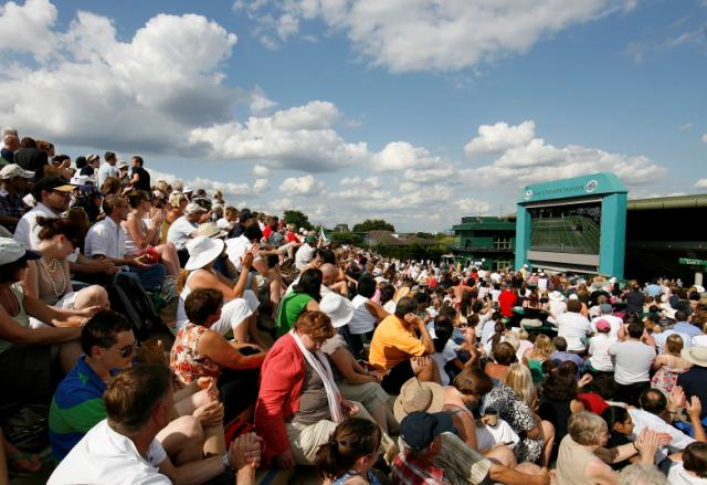 People gather on what is affectionately known as 'Murray's Mount' to watch a match. The history of Wimbledon Tennis: where it all began