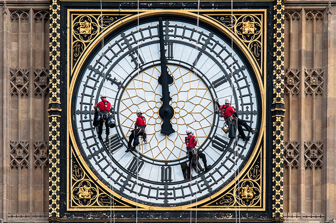 Workers on Big Ben's clock face. Big Ben's chimes sound for last time in four years