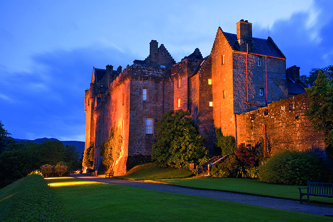 Brodick Castle on the Isle of Arran at dusk. Credit: Scottish Viewpoint/Alamy