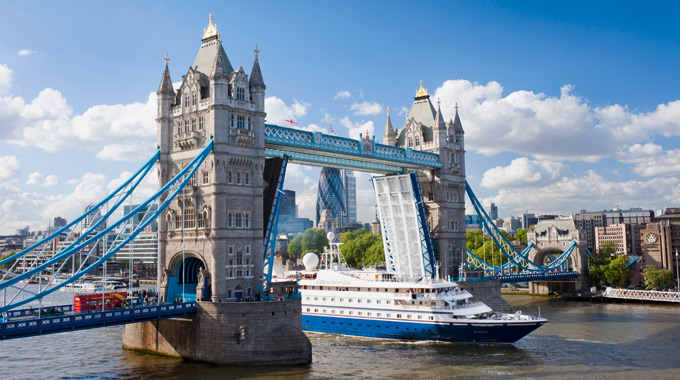 A cruise ship passing through London's imposing Tower Bridge