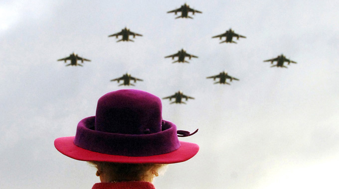 The Queen watches a flypast of RAF Jaguars in a Diamond 9 Formation January 2006