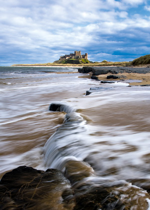 Looking towards Bamburgh Castle on its rocky plateau above the sea