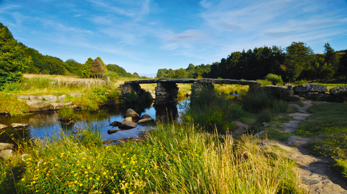 The ancient clapper bridge over East Dart River on Dartmoor