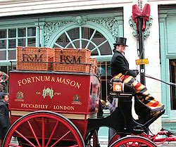 A Fortnum & Mason hamper delivered by horsedrawn carriage