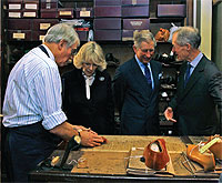 The Prince of Wales and Camilla, Duchess of Cornwall, explore the rough stuff department at John Lobb