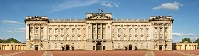 Buckingham Palace, the Queen's principal residence and workplace in London. The facade of the historic royal palace founded in the 18th century, and remodelled in the 19th century. This image must be reproduced with the Credit: VistBritain/Andrew Pickett