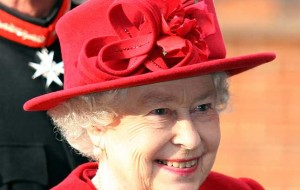 HM The Queen resplendent in red Credit: Getty Images/Shutterstock
